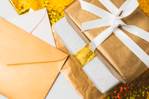 Close-up of presents with envelopes