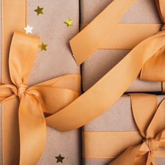 Close-up of presents with golden stars and ribbon