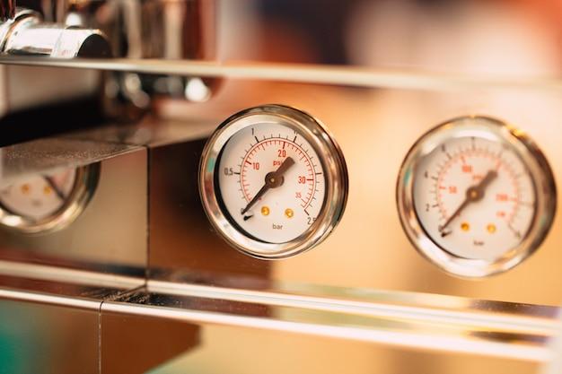 Close up of pressure gauge at coffee espresso machine