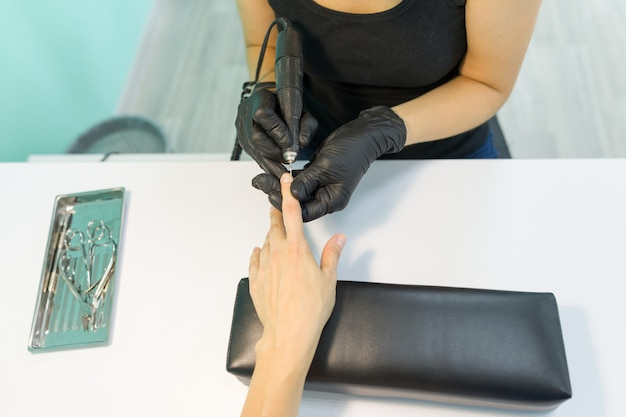 Close-up process of professional manicure