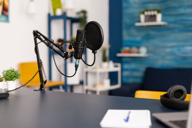 Close up of professional equipment for recording podcast in vlogger home studio. influencer making social media content with production microphone and digital web internet streaming station