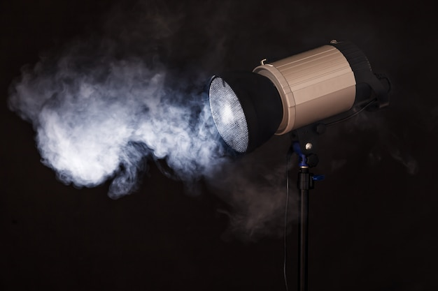 Close-up of professional studio light. concept photoshoot in fog