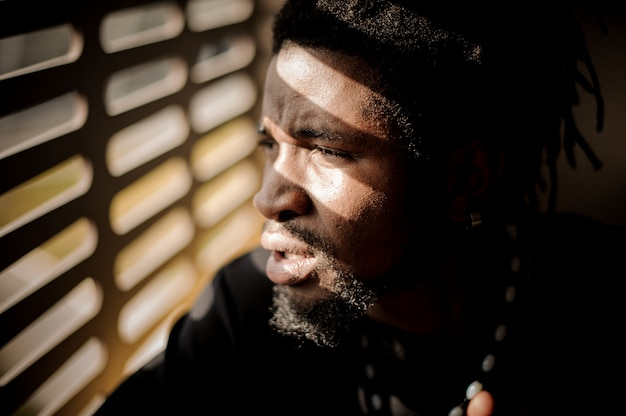Close up profile portrait of bearded afro american man
