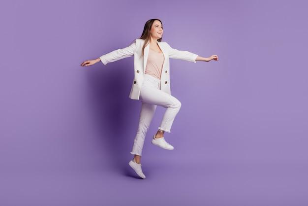 Close up profile portrait of lady jump run wear formal suit headwear posing on purple wall