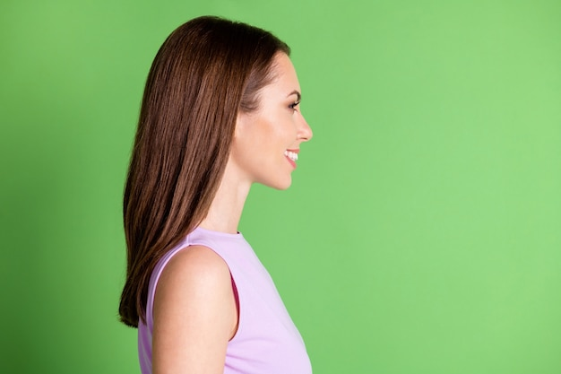 Close-up profile side view of her she nice-looking attractive pretty lovely charming winsome adorable cheerful cheery girl modern haircare isolated green color background