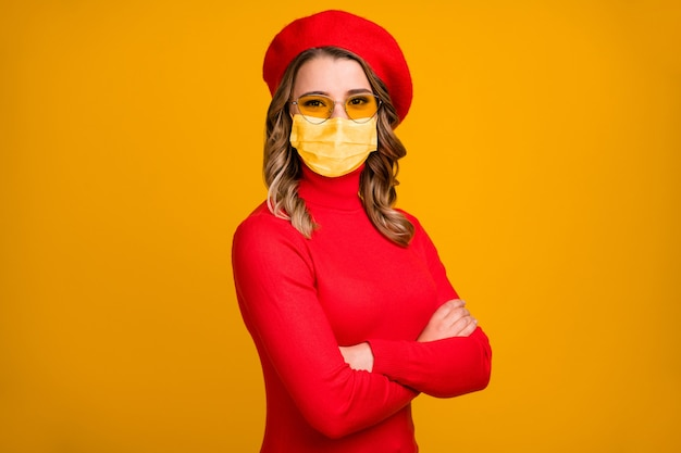 Close-up profile side view portrait of her she nice attractive charming pretty wavy-haired girlfriend folded arms wear medical mask isolated on vivid shine yellow color background