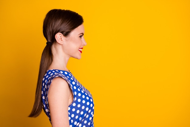 Close-up profile side view portrait of her she nice-looking attractive pretty lovely cheerful cheery girlfriend copy space isolated on bright vivid shine vibrant yellow color background