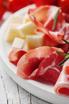 Close up of prosciutto and cheese