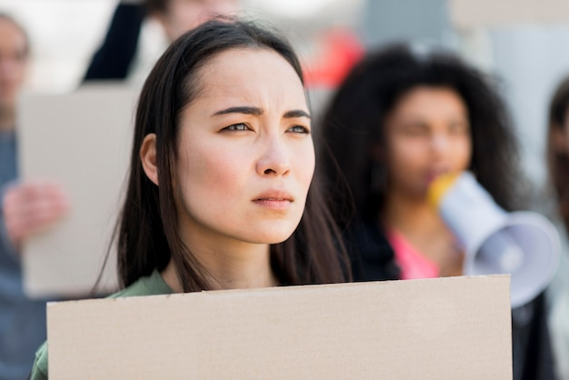 Close-up protester holding a cardboard