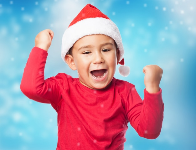 Close-up of proud child with santa hat
