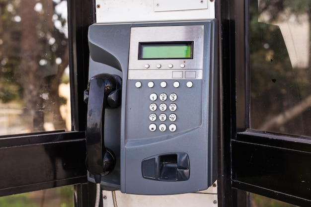 Close up of the public pay phone on the street