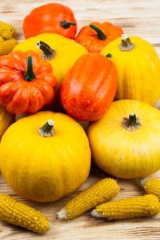 Close-up pumpkins with corn