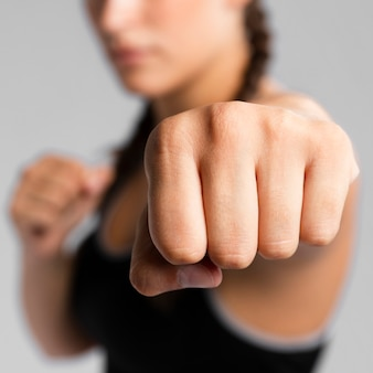 Close-up punch of a gym fit blurred woman