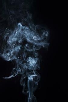 Close-up of purple steam smoke design on black background