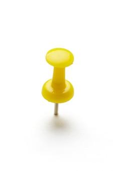 Close up of a pushpin on white