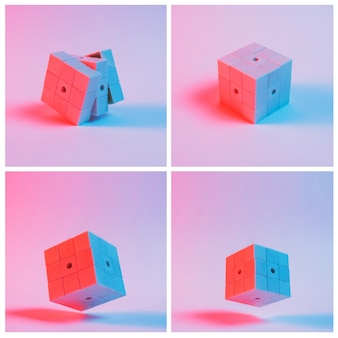 Close-up of puzzle cubes against pink background with shadow