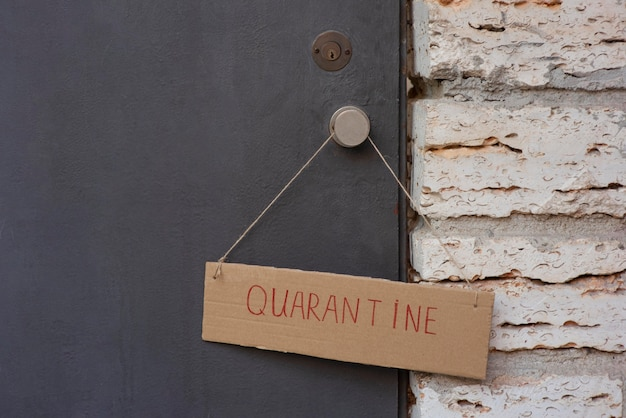 Close-up of quarantine sign on front door