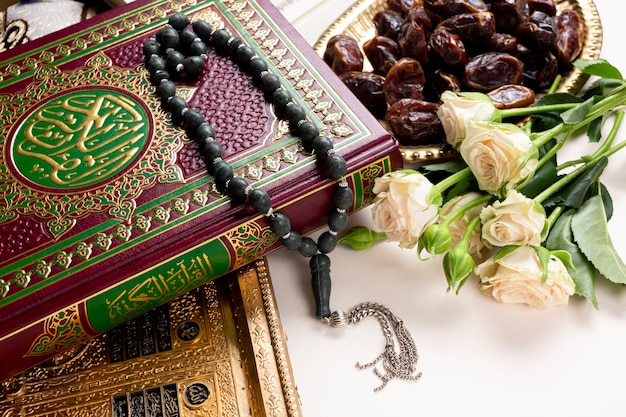 Close up quran and bouquet of flower