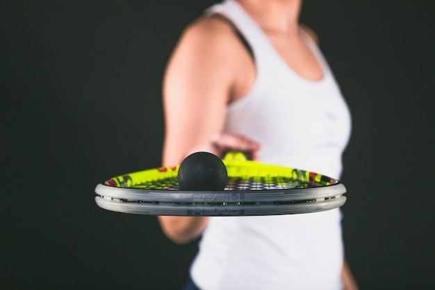 Close-up of racquet and ball