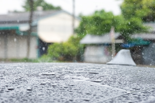 Close-up raindrop falling on roof car