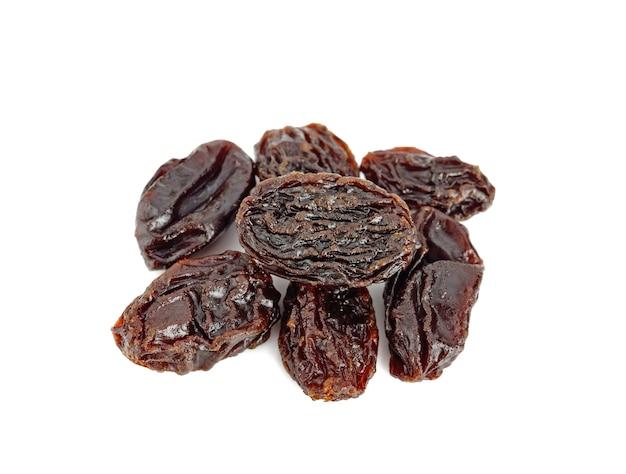Close up raisins isolated on white background