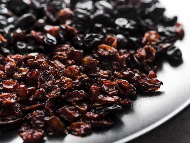 Close-up raisins in white plate