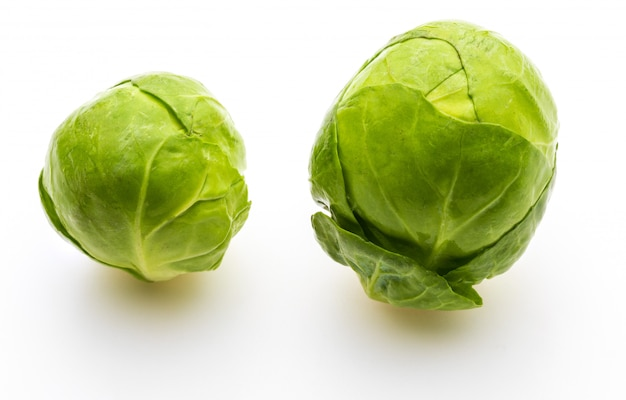 Close-up of raw, fresh and whole brussels sprouts (cabbages - brassica oleracea). isolated on white background.