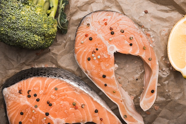 Close-up raw salmon steak broccoli and lemon