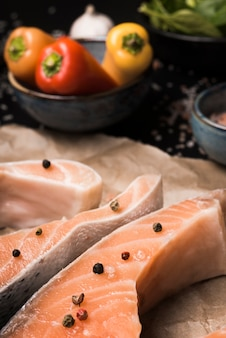 Close-up raw salmon steak with ingredients