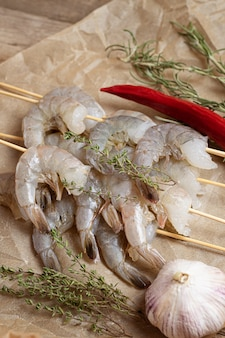 Close up of raw shrimps on a baking paper