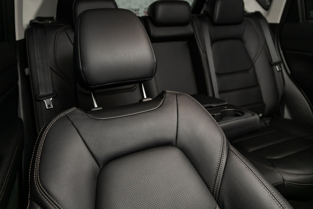 Close-up rear seat made of black leather with a head restraint