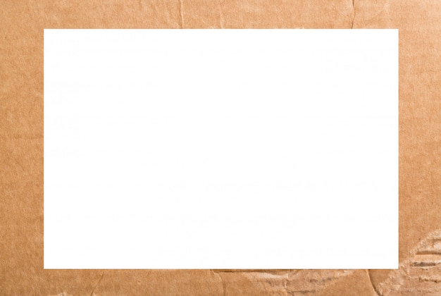 재활용 골판지 또는 갈색 보드 크래프트 종이 상자 프레임 질감 배경을 닫습니다