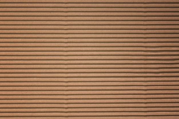 재활용 골 판지 또는 갈색 보드 크 라프 트 종이 상자 질감 배경을 닫습니다.