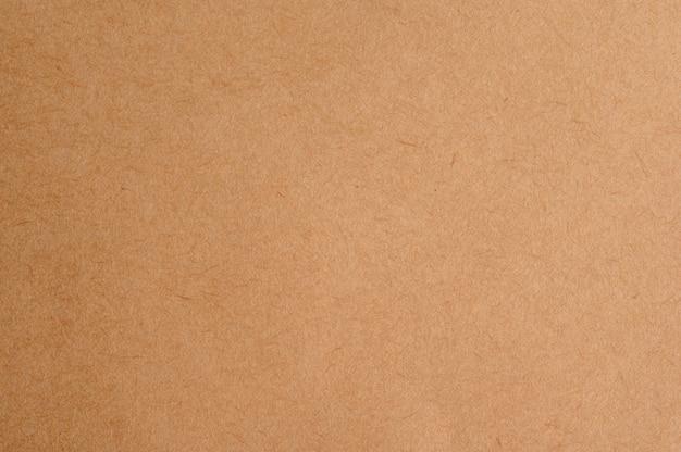 リサイクル段ボールまたは茶色のボードクラフト紙箱テクスチャ背景を閉じる