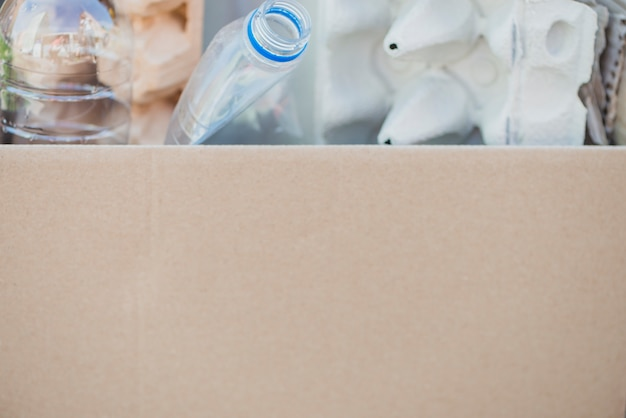 Close-up of recycle items in the cardboard box