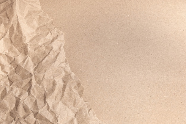 Close up of recycled brown wrinkle crumpled old with paper page texture rough background.