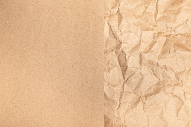 Close up of recycled brown wrinkle crumpled old with paper page texture Premium Photo