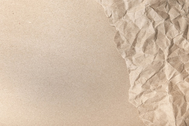 Close up of recycled brown wrinkle crumpled old with paper page texture