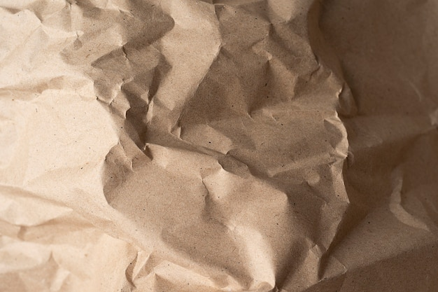 Close up of recycled brown wrinkle paper texture for background or design or art work. top view close up paper background