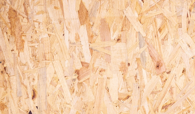 Close up of recycled compressed wood chippings board abstract texture background