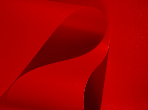 Close-up red abstract curved monochrome paper
