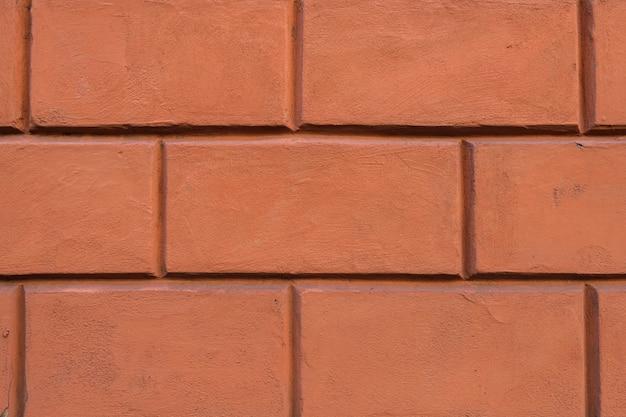 붉은 벽돌 벽 세부를 닫습니다