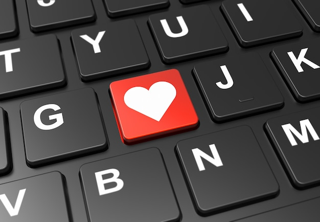 Close up red button with heart sign on black keyboard