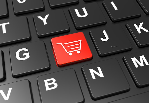 Close up red button with shopping cart on black keyboard