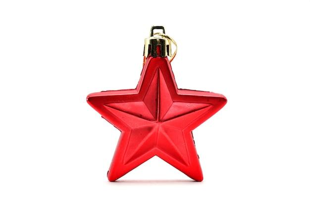 テーブルの上の赤いクリスマスの星を閉じる