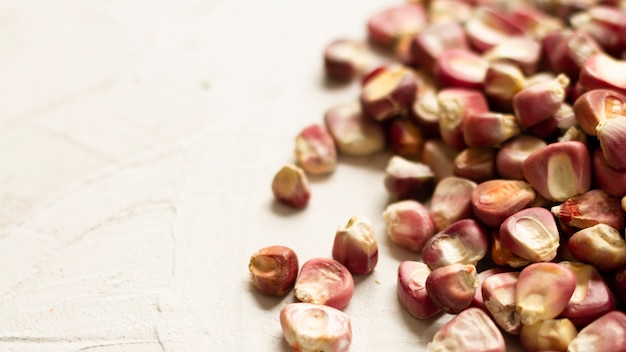Close-up red corn kernels on table