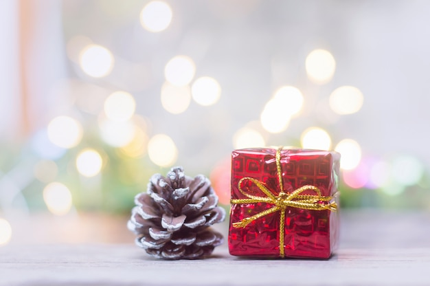 Close up of red gift box and pinecone for christmas or new year decoration background