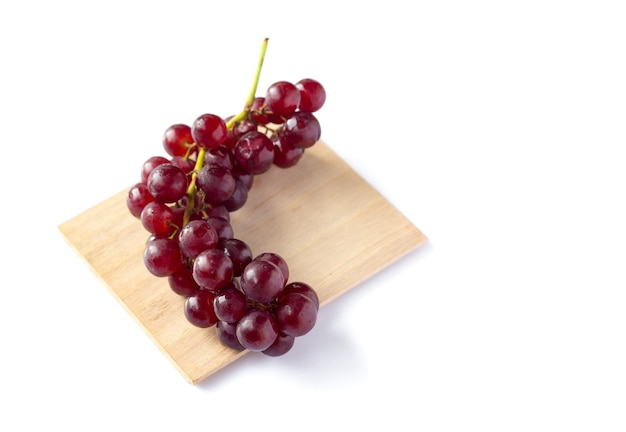Close up on red grape isolated