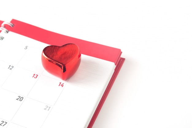 Close up red heart on calendar on white background, valentine concept