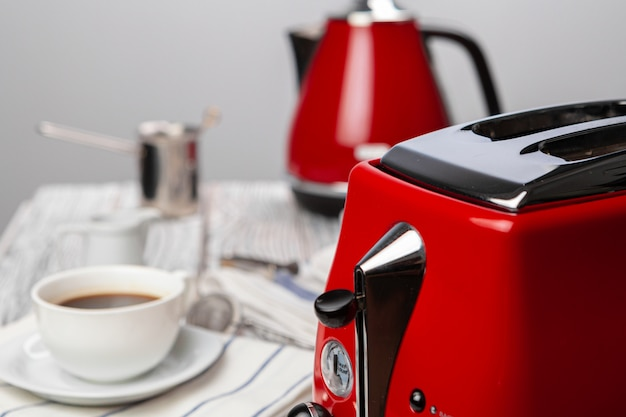 Close up of red kitchen .appliances on kitchen table